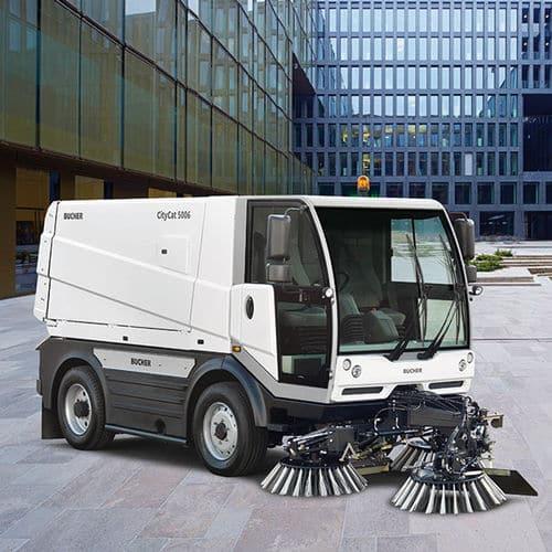 A Bucher Municipal ride-on street sweeper